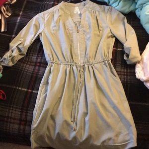 A greenish color dress